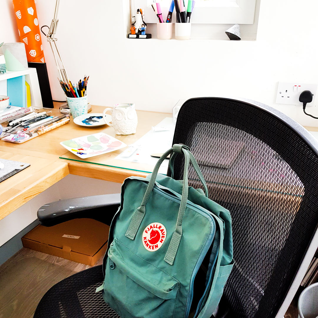 Kanken bag resting on chair in personal workspace